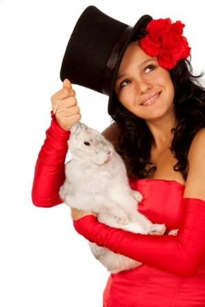Closeup portrait of  a cute magician with  bunny against white background